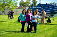 Young women gather on the practice field where the Aviation Patrol Division of the Contra Costa Sheriff's Office landed a helicopter