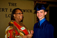 Nathan Eschliman, the sole male in the graduating class, smiles warmly as Michelle Stewart looks on