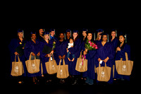 Graduates show off gift bags from County Supervisor,  Federal Glover