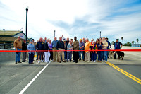 Large crowd gathers with Supervisor Glover for the ribbon cutting